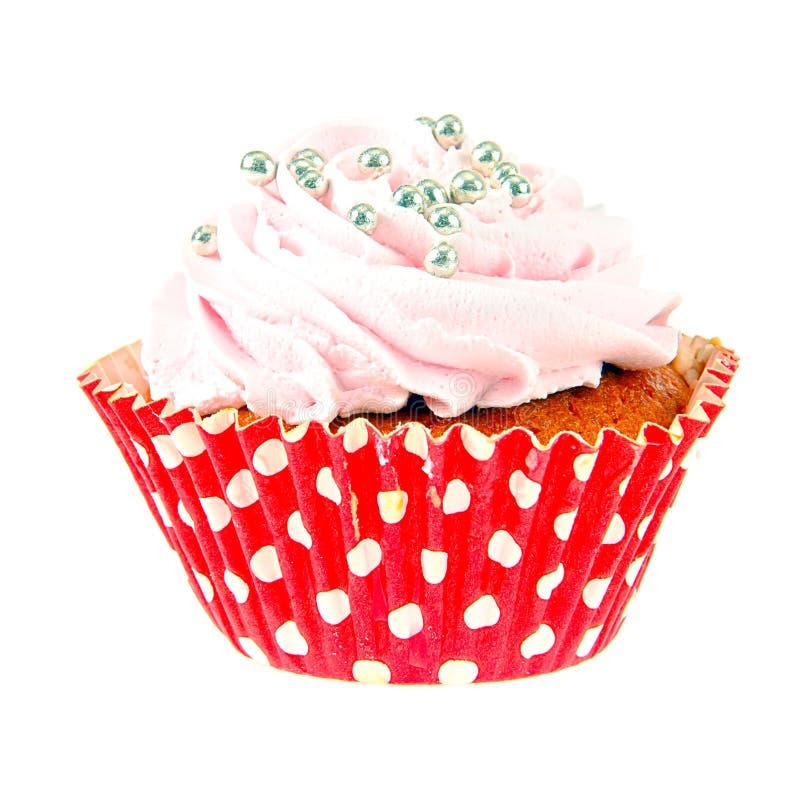 与奶油,在白色背景的杯形蛋糕的蛋糕 免版税库存图片