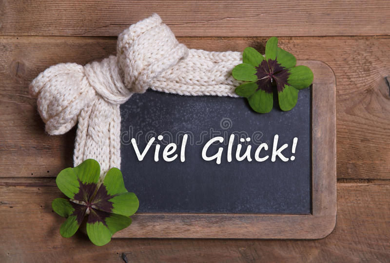 与好运消息的菜单板用德语-三叶草和白色 库存图片
