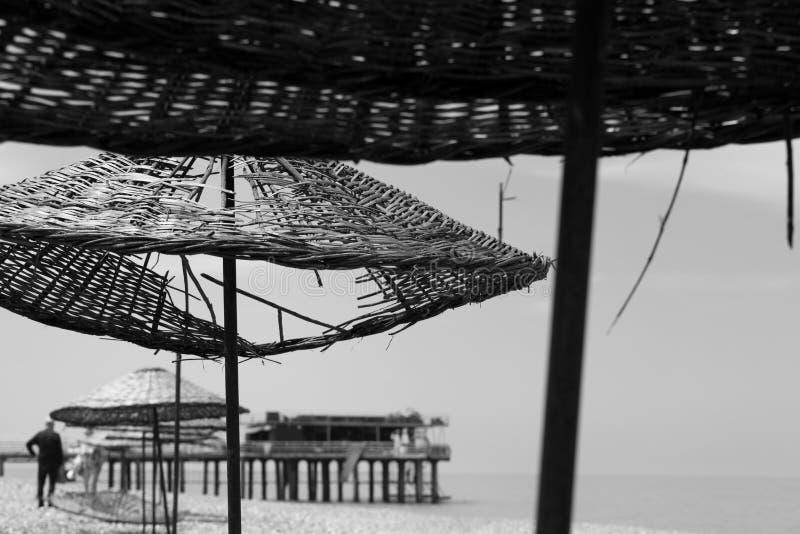 与孔的老遮光罩在海滩 图库摄影