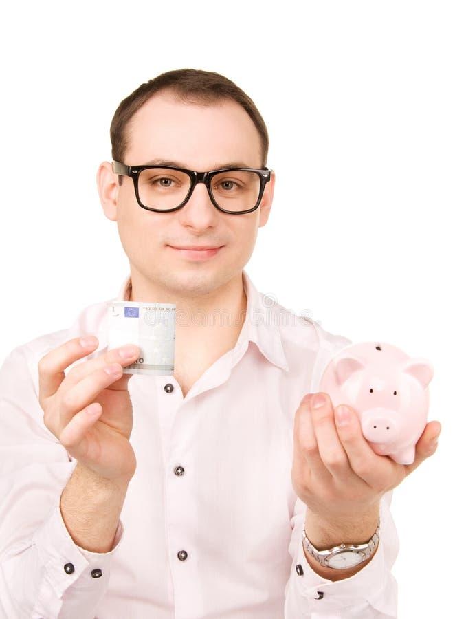 与存钱罐和金钱的商人 免版税库存照片