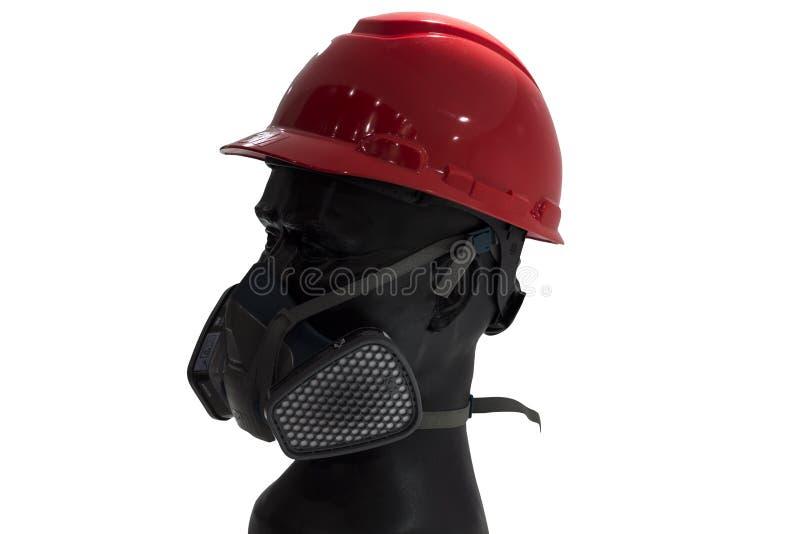 与安全帽的一个时装模特和气体过滤面具;白色backg 免版税库存图片