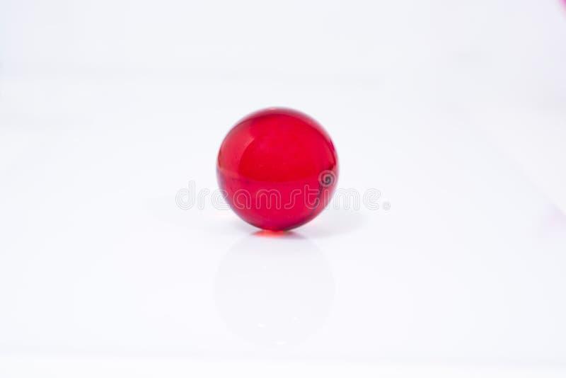 与小玻璃球的抽象照片在透明背景 库存照片