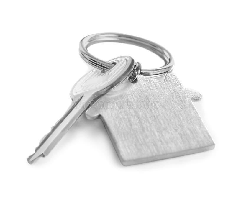 与小装饰品的钥匙在白色背景 保险经纪人 免版税库存照片