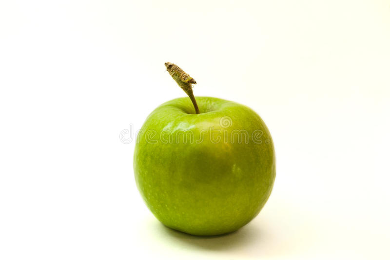 与尾巴的绿色苹果 免版税库存图片