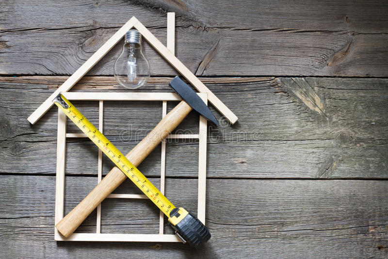 与工具的家庭整修建筑摘要背景 免版税库存图片