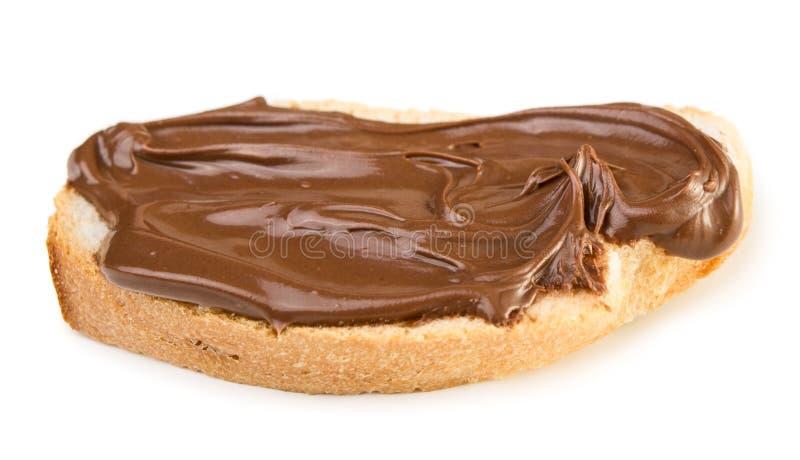 与巧克力传播的面包 免版税图库摄影