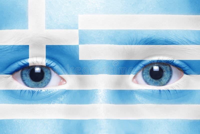 与希腊旗子的人的` s面孔 免版税库存照片