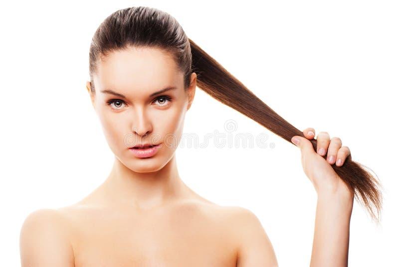 与干净的皮肤的美丽的妇女的表面在白色 库存照片
