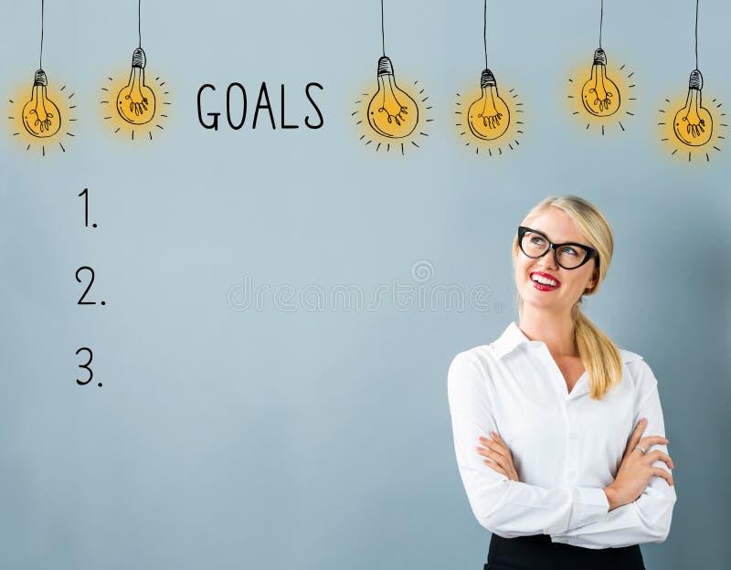与年轻女人的目标名单 免版税库存照片