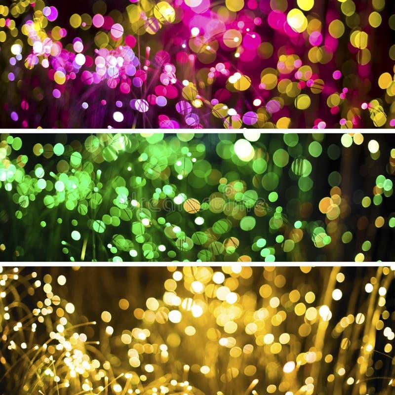 与幻想bokeh纹理紫色氖的抽象背景和金黄 时兴的套三圣诞节背景 图库摄影