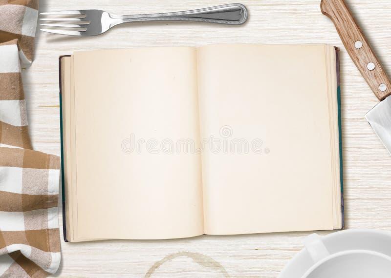 与开放书的烹调的食谱厨房用桌或习字簿 库存图片