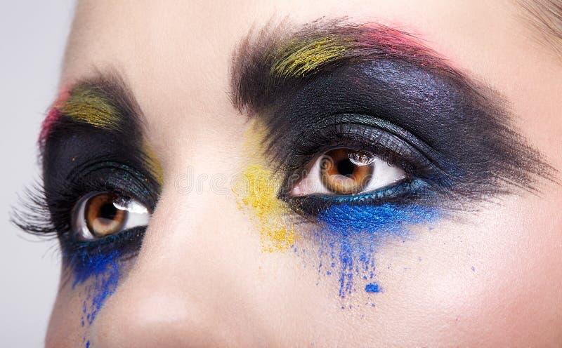 与异常的艺术性的绘的构成的女性眼睛 免版税库存照片