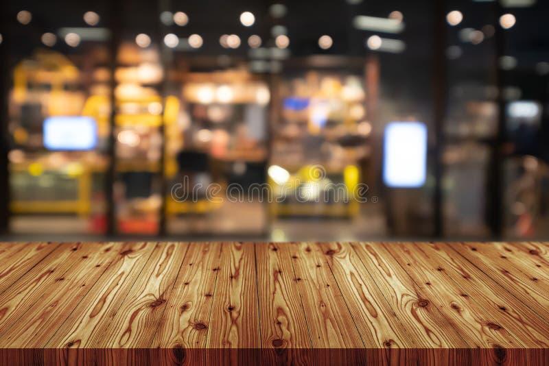 与弄脏的空的木台式百货店背景,抽象背景可以为您的显示或的蒙太奇使用 库存图片
