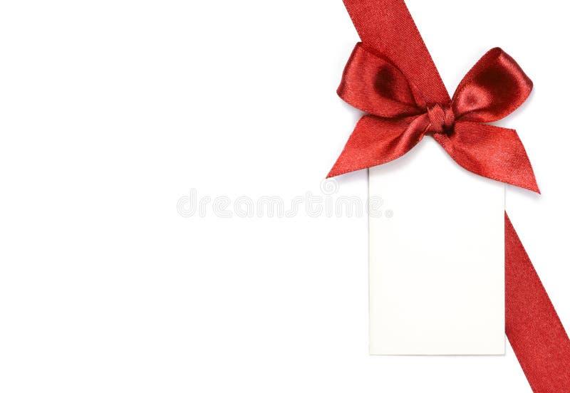 与弓和卡片的红色丝带 库存图片