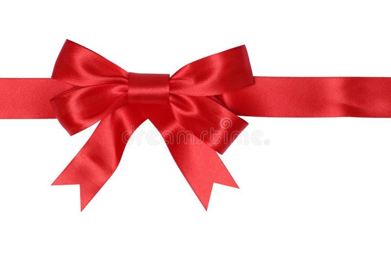 与弓的红色丝带礼物在圣诞节或华伦泰da的礼物的 免版税库存图片