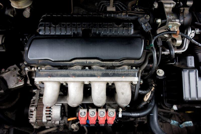 与引擎的红色LPG注射器 免版税库存照片
