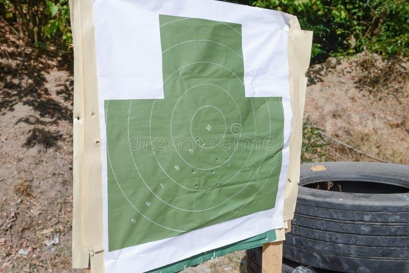 与弹孔的目标在靶场 库存照片