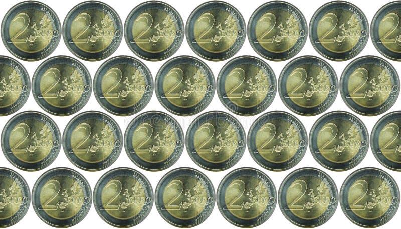 与很多欧洲货币2欧洲硬币的背景 背景查出的白色 免版税库存图片