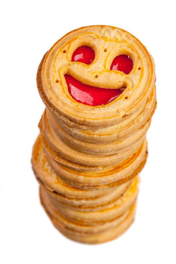 与微笑的圆的曲奇饼被隔绝的堆  库存图片