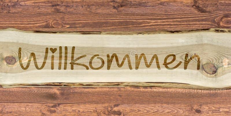 与德国词的木字法欢迎的作为题字 免版税库存照片