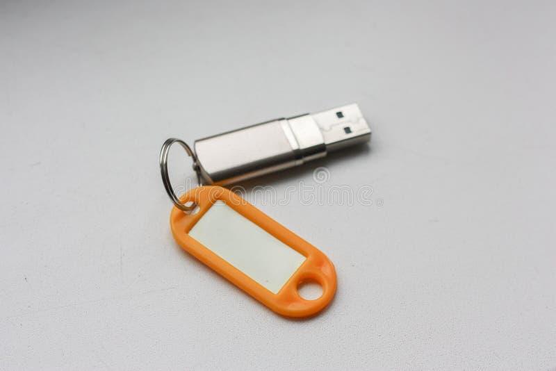 与徽章钥匙的一刹那驱动 库存图片