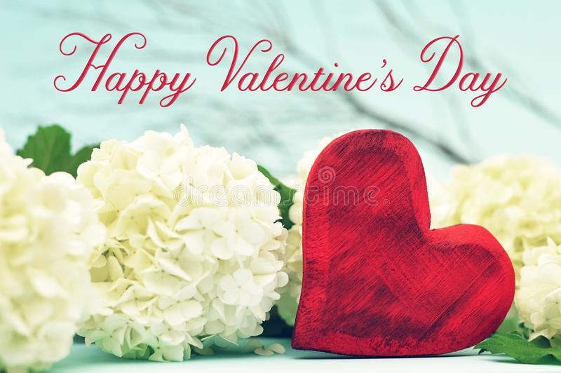 与心脏和花的愉快的情人节卡片 库存照片