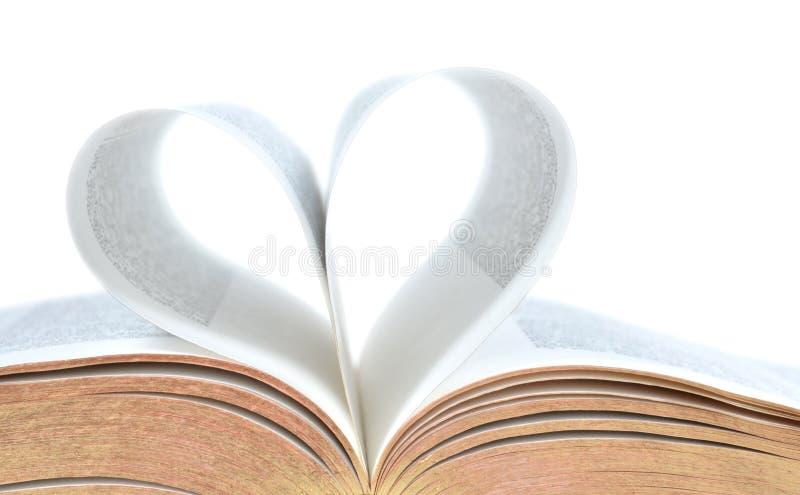 与心脏形状的圣经在页 免版税库存图片