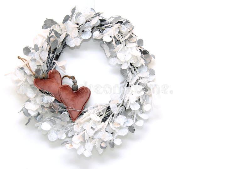 与心脏的典雅的圣诞节花圈 图库摄影
