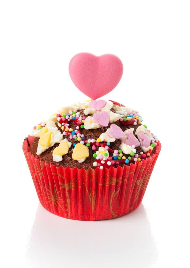 与心脏的杯形蛋糕 免版税库存图片
