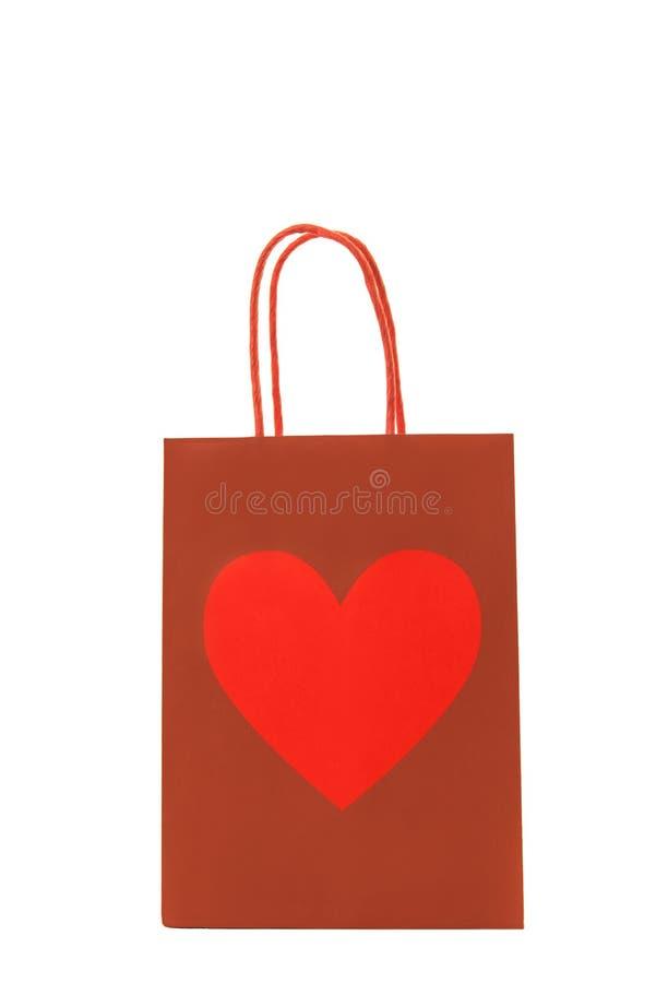 与心脏的红色礼物袋子对此 免版税库存图片