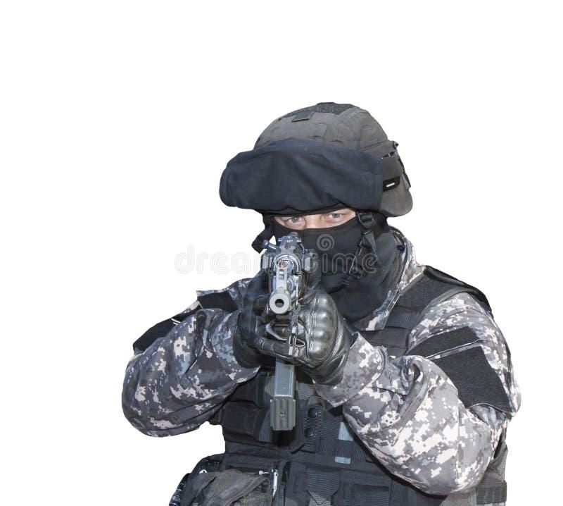 与恐怖主义,特种部队战士作战,有攻击步枪的,警察扑打 免版税库存图片