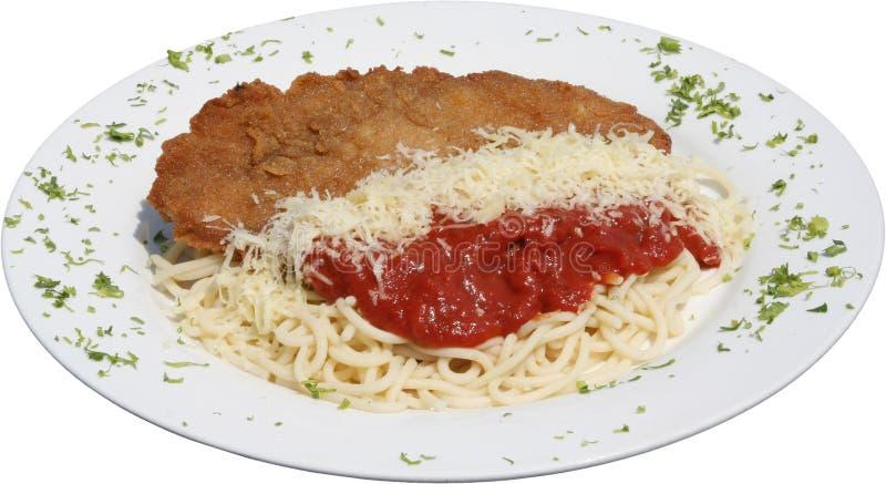 与意大利面团和西红柿酱的油煎的猪排炸肉排 免版税图库摄影