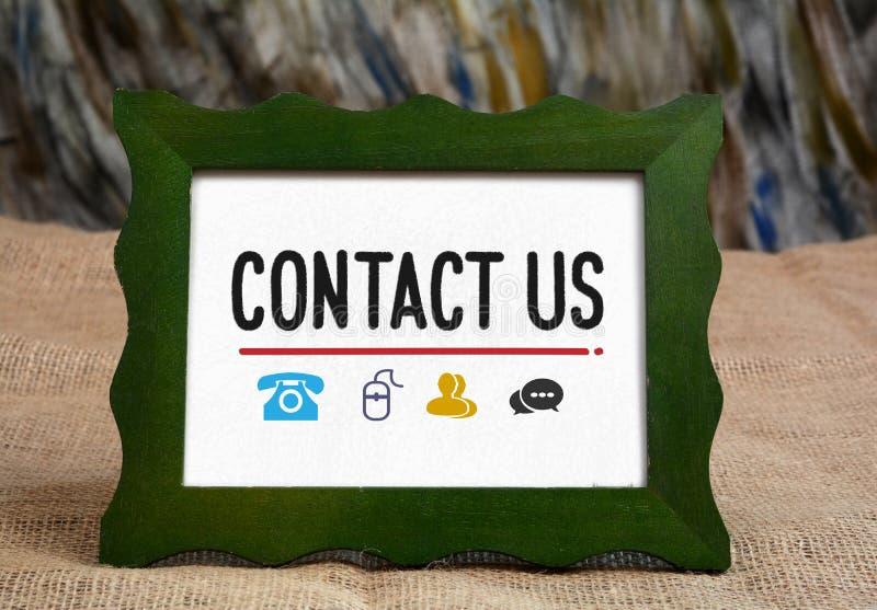 与我们联系与电话和通信象  免版税库存图片