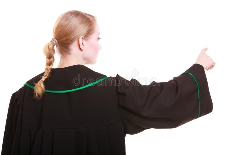 与手指的妇女波兰律师后面视图指向的方向 免版税库存照片