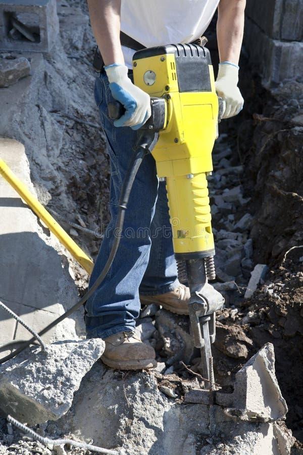 与手提凿岩机的体力劳动 免版税图库摄影