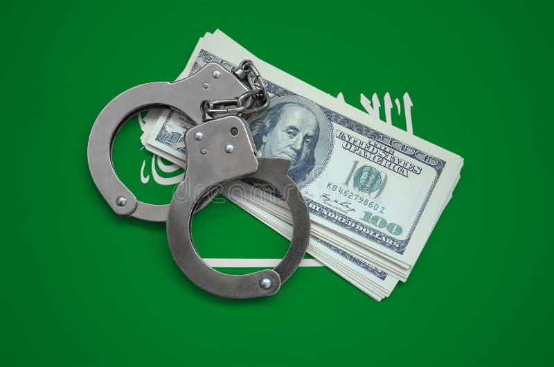 与手铐的沙特阿拉伯旗子和捆绑美元 货币腐败在国家 财政罪行 库存图片