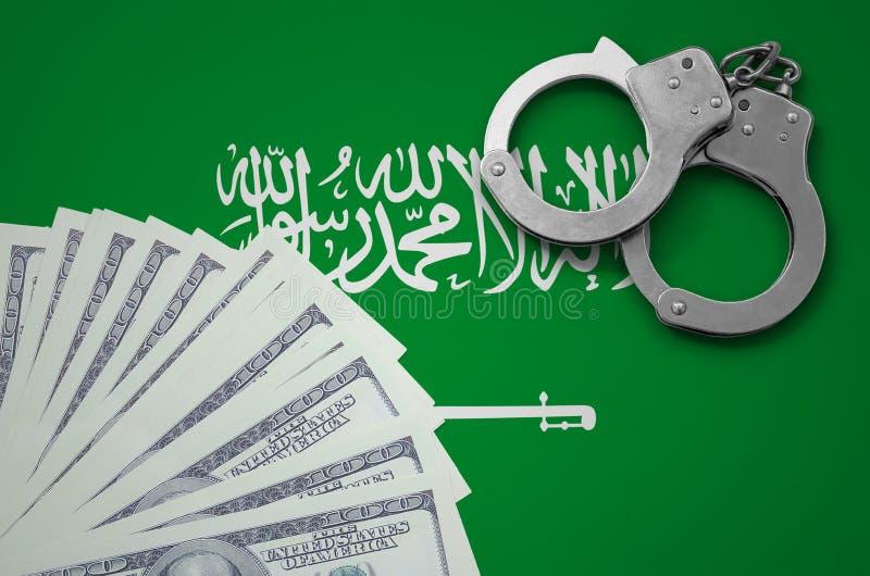 与手铐的沙特阿拉伯旗子和捆绑美元 非法银行业务的概念在美国货币的 库存图片