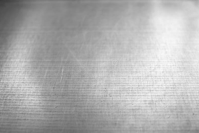 与抓痕和凹痕的残酷金属纹理背景 免版税图库摄影
