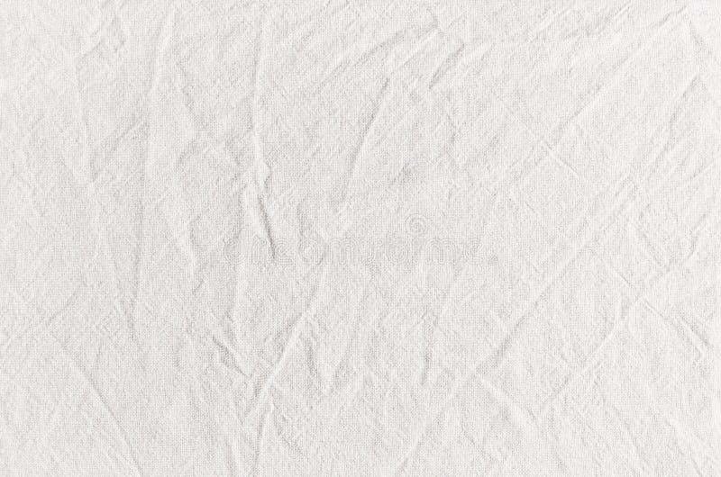 与折痕的白色棉花帆布织品纹理 免版税库存图片
