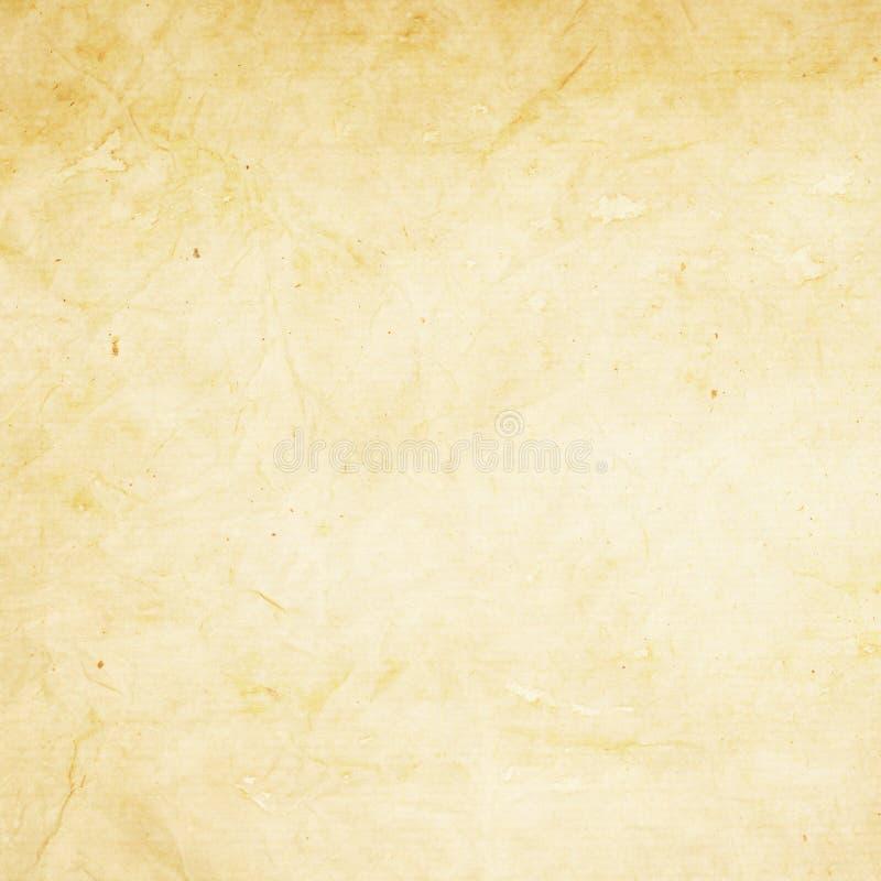 与折痕的老淡黄色纸纹理 免版税库存照片