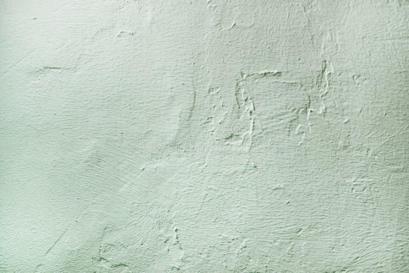 毛面膏药纹理 与拷贝空间的薄荷的淡色浅兰的颜色背景 被构造的装饰涂灰泥 免版税库存照片