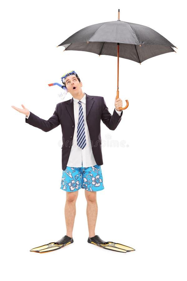 与拿着伞的潜水面具的商人 库存图片