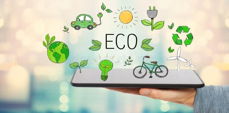 与拿着片剂的人的Eco 免版税库存图片