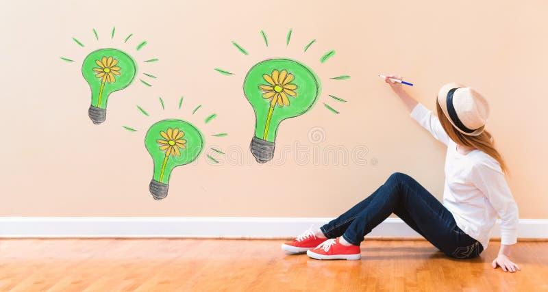 与拿着笔的少妇的Eco能量 库存图片