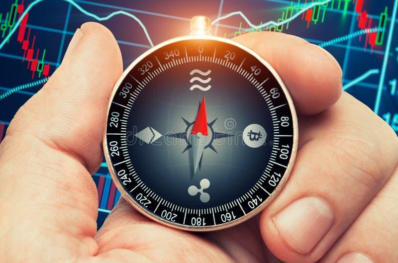 与指南针的Cryptocurrency概念在手中 免版税图库摄影