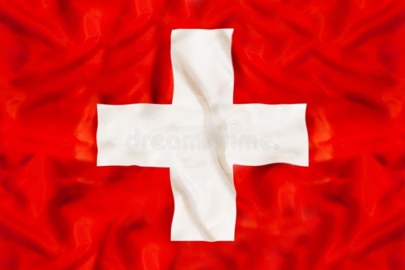 与挥动的织品的瑞士国旗 库存照片
