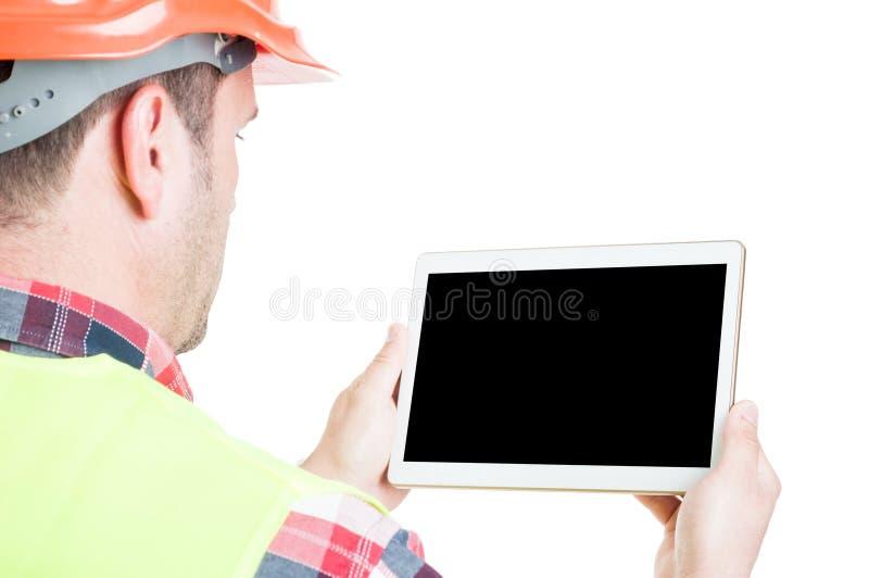 与数字式片剂的男性建造者 库存图片