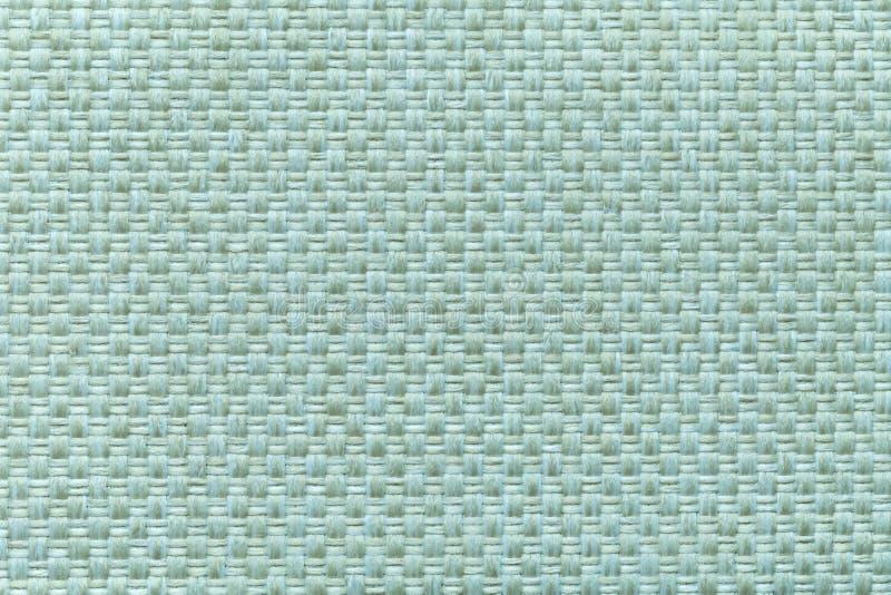 与方格的样式,特写镜头的轻的深蓝纺织品背景 织品宏指令的结构 免版税图库摄影