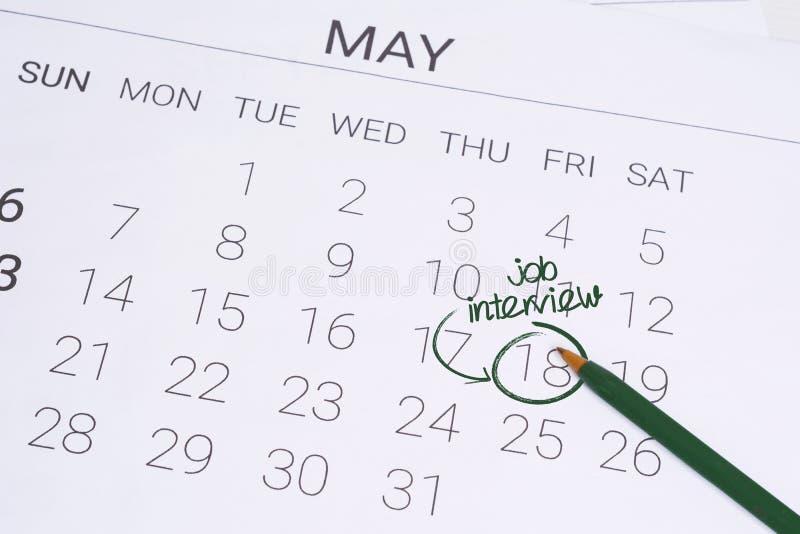 与日期提示的日历关于工作面试 免版税库存照片