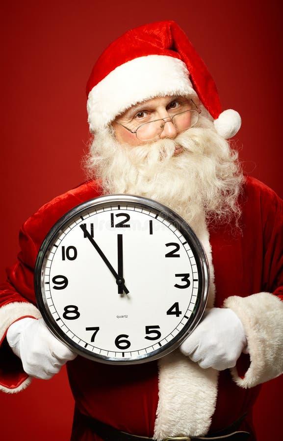 与时钟的圣诞老人 免版税库存图片